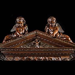 A very imposing Venetian Baroque style Antique walnut Chimneypiece