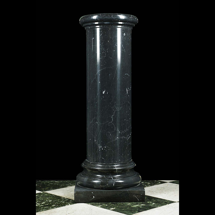 A 20th century black marble column