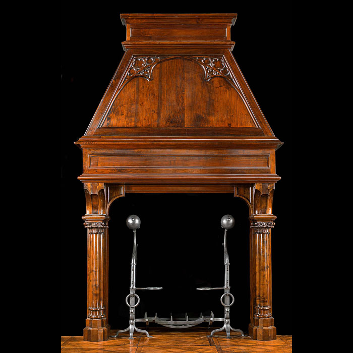 13603: An unusually tall and imposing Gothic Revival antique trumeau fireplace surround. The elegant triple cluster columns with their finely carved capitals support a plain panelled frieze, above which is t