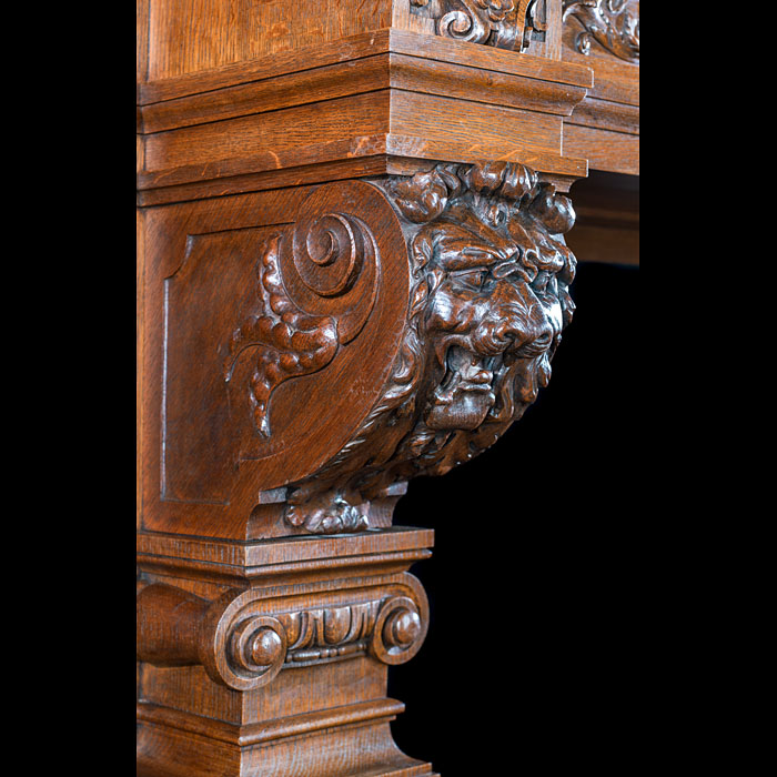 A large baroque style antique carved oak fireplace surround & overmantle