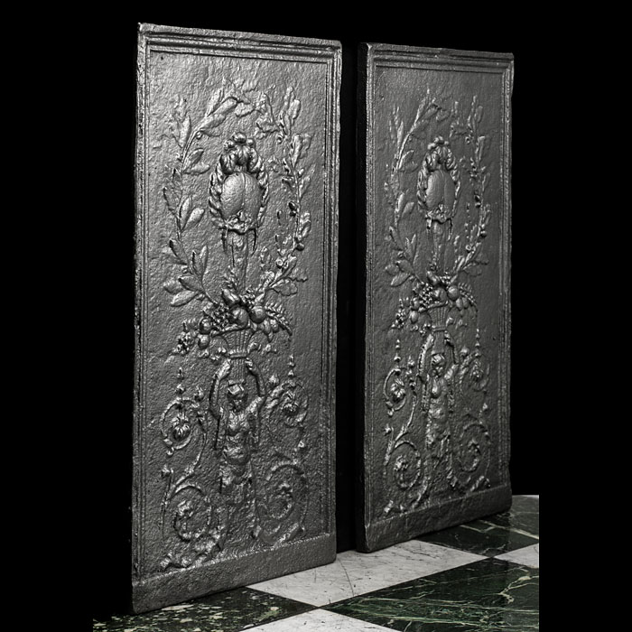 An Antique pair of cast iron fireplace panels