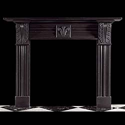 An antique Regency fireplace mantel in Welsh slate