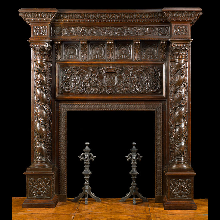 An antique Renaissance style carved oak chimneypiece