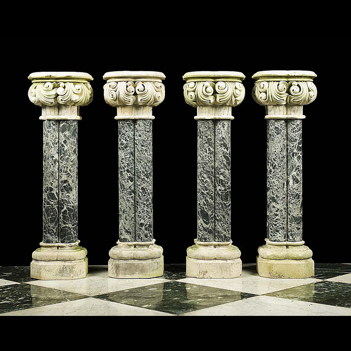 A set of four antique stone and marble cluster columns