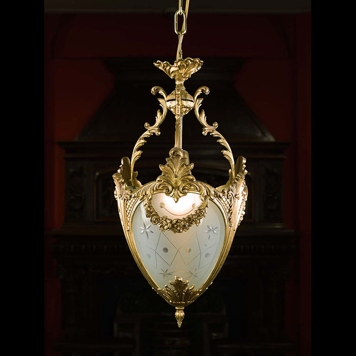 An ornate Regency style 20th century brass ceiling light