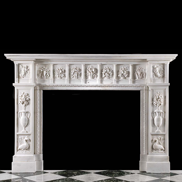 13686: A rare and substantial Aesthetic Chimneypiece on a grand scale exquisitely carvedin lightly veined statuary marble. The colonnade frieze enclosing deeply carved floralpanels flanked by endblocks depic
