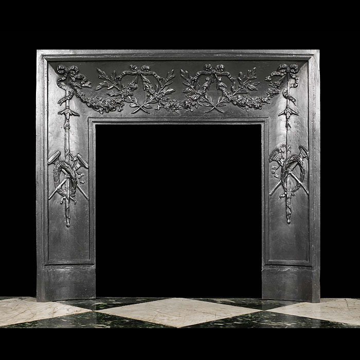 An antique Victorian fireplace insert in the Louis XVI style