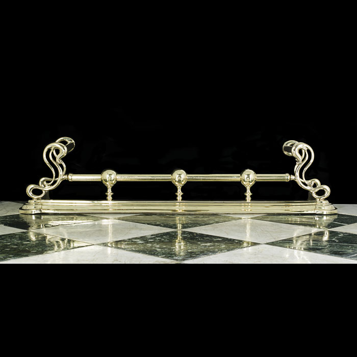 An Art Nouveau Antique brass fireplace fender
