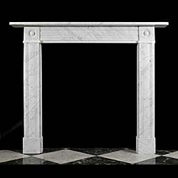 13712: One of a pair, with  SNo 13488, of small elegant Victorian bullseye fireplace surrounds in richly veined Carrara Marble.English, circa 1840.    Link to: Antique Victorian, William IV, Arts and Crafts,