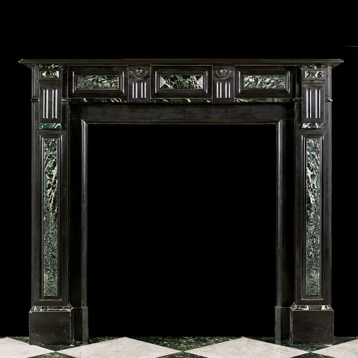 13726: A smart but small Belgian Black and Verde Antico marble chimneypiecein the Baroque manner. The verde antico detailed frieze, centred by alozenge and alternating fluted bossed detail echoed on the endb