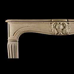 An Antique Louis XV stone chimneypiece