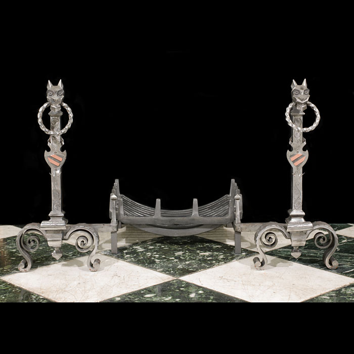 A pair of wrought iron Antique Gothic style firedogs