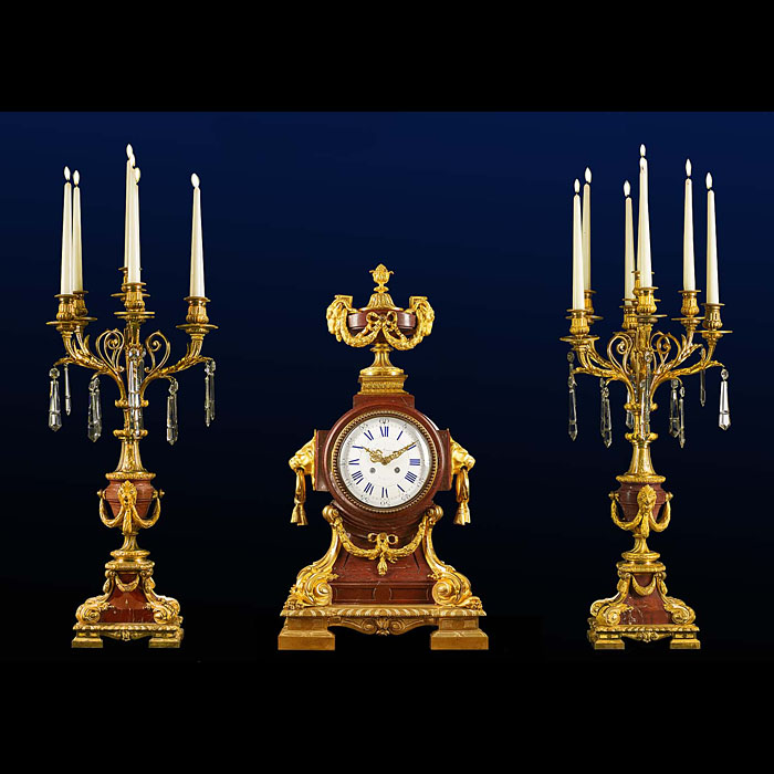 A very fine ormolu and Rosso Alicante antique marble clock garniture