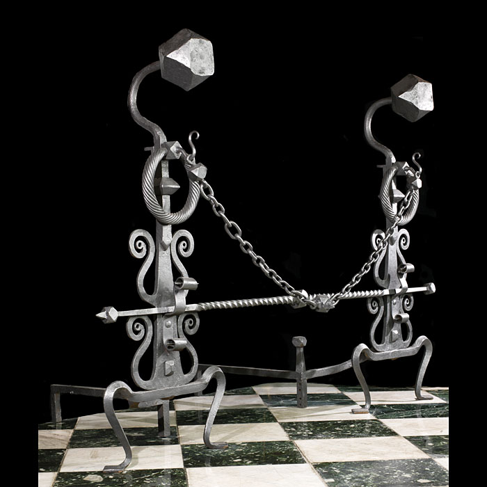 A huge pair of Antique wrought iron Baroque style andirons