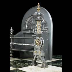 A Baroque style steel and brass antique Victorian fire grate