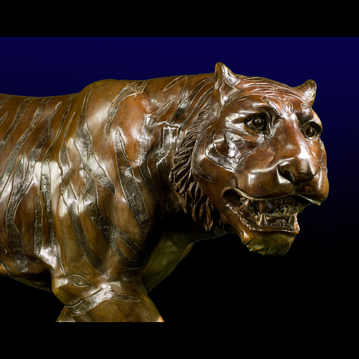 A powerful life size bronze model of a tiger