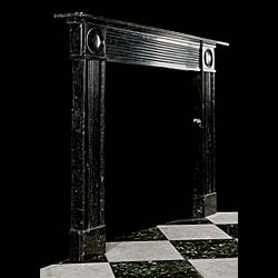 An Antique chimneypiece in black fossil marble