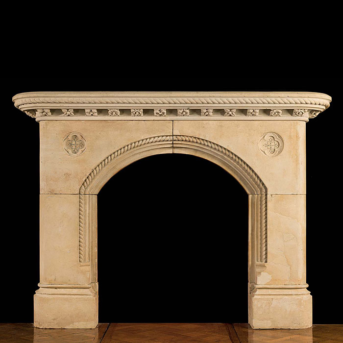 A Gothic Revival Antique chimneypiece in the manner of Pugin