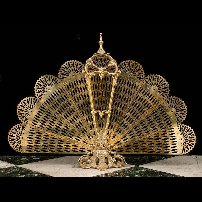 13766: An attractive brass Peacock fan shaped folding firescreen in the Rococo style. French early 20th century.    Link to:  Antique Fenders, Firescreens and Nursery Guards