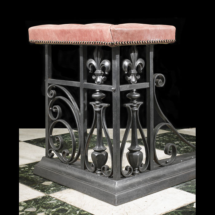An antique club fireplace fender in the Gothic style