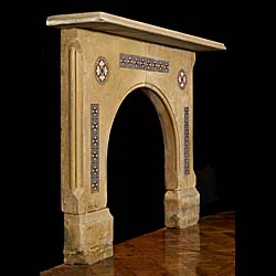 An antique arched fireplace inlaid with Minton Gothic revival tiles.