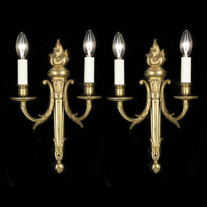 A pair of classical style brass wall lights