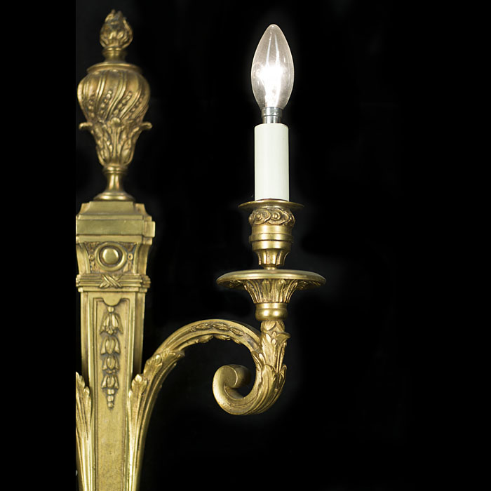 A 20th century pair of large Neoclassical style twin branch wall lights