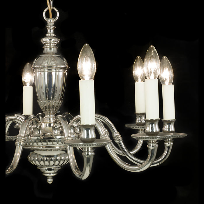 A 20th century ten branch nickel plated brass chandelier