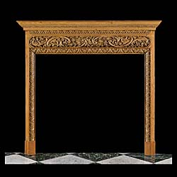 13813: A carved pine antique chimneypiece in George II style. The barrel frieze, well carved with scrolled floral decoration under the delicately carved and moulded shelf. The opening is bounded by richly ca