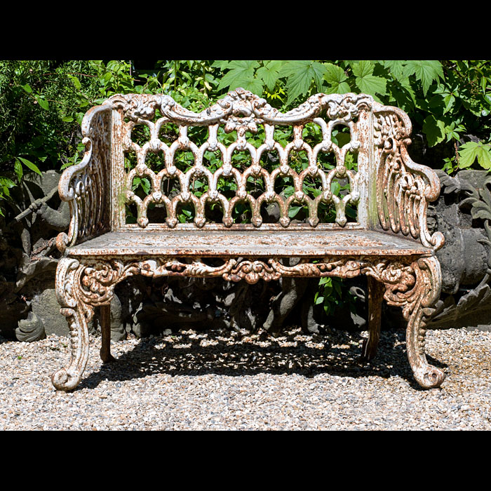 A 2oth century cast iron Rococo style garden seat