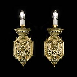 A pair of large Baroque style antique wall lights