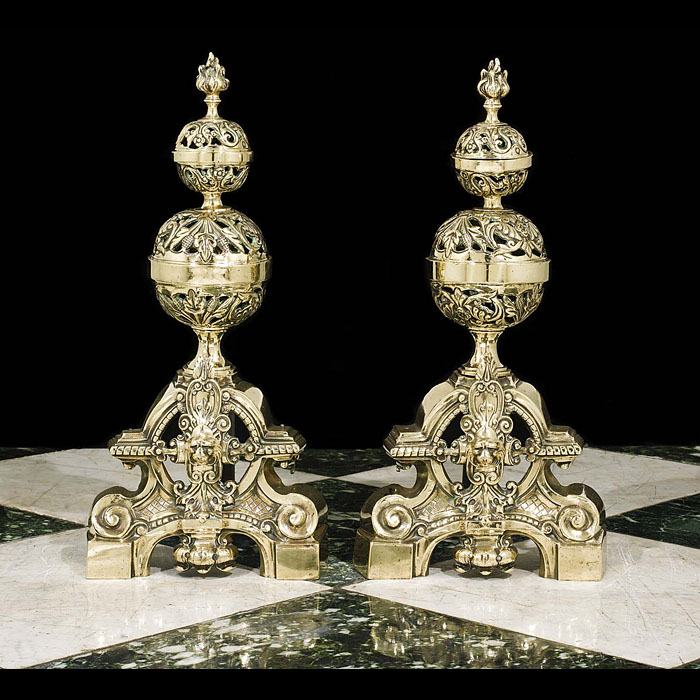 A pair of antique Baroque style brass chenet