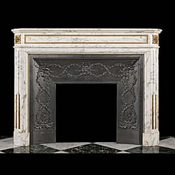 13841: A Louis XVI style veined white arabescato marble fireplace with decorative ormolu beading on the panelled frieze and around the opening, a pair oformolu paterae on the endblocks and stopped fluted jam