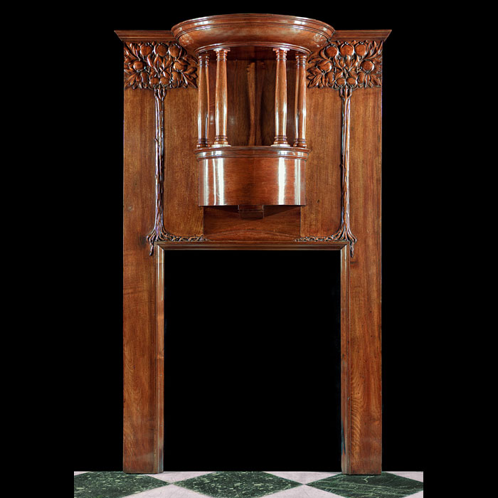 An Antique Art Nouveau Walnut Fire Surround