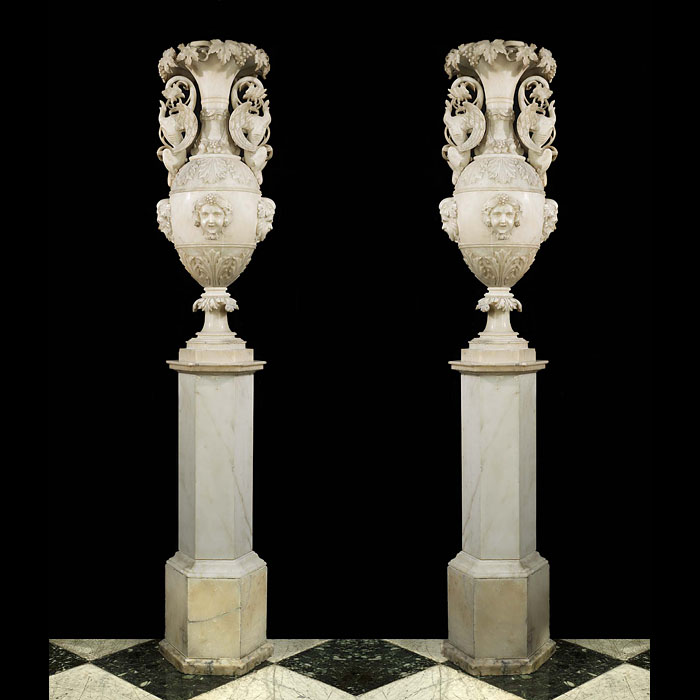 13844: A large pair of superbly carved antique, translucent white Alabaster urns in celebration of Bacchus the God of wine. The main body is decorated with bands of Acanthus leaves and Bacchanalian masks. Th