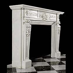 13864: A substantial and profusely carved chimneypiece in White Carrara BiancoPi marble. The frieze, with entwined ribboned floral, foliate panels, has acentral panel depicting a quiver and arrows lying amon