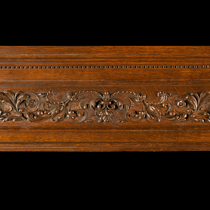 A tall Renaissance style carved oak antique chimneypiece mantel