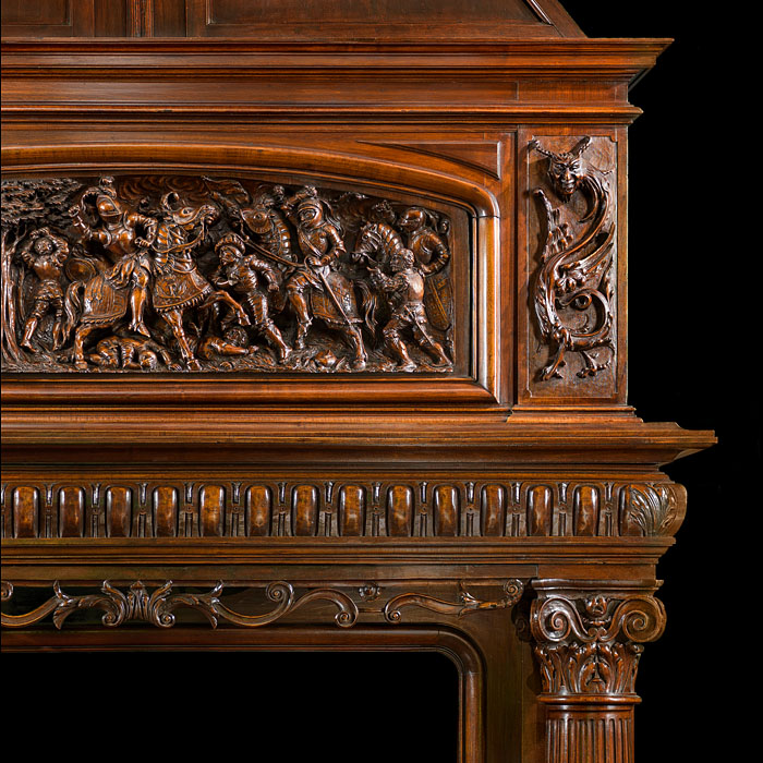 An Antique French Carved Walnut Trumeau Fireplace Surround