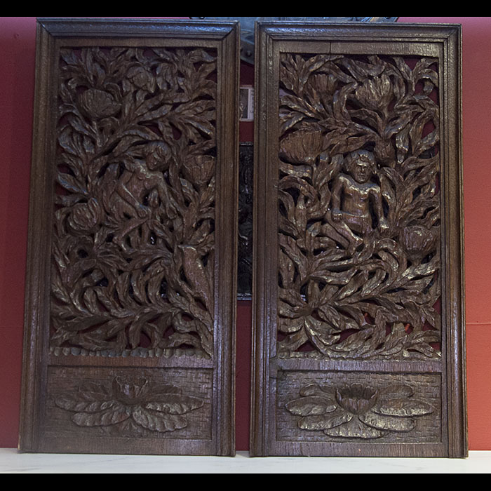 A pair of profusely carved oak panels