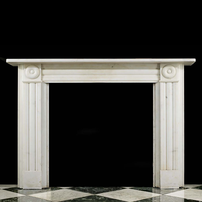 13910: An elegant creamy white Statuary Marble bullseye chimneypiece the mouldedfrieze flanked by the bullseye endblocks above panelled jambs.English mid 19th century.    Link to: Antique Victorian, William