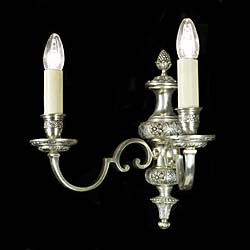 Highly decorative set of four Regency style silvered brass wall lights