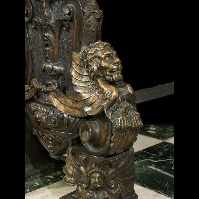 A pair of majestic bronze Baroque style andirons