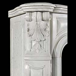 An Antique Frernch Rococo style fireplace surround