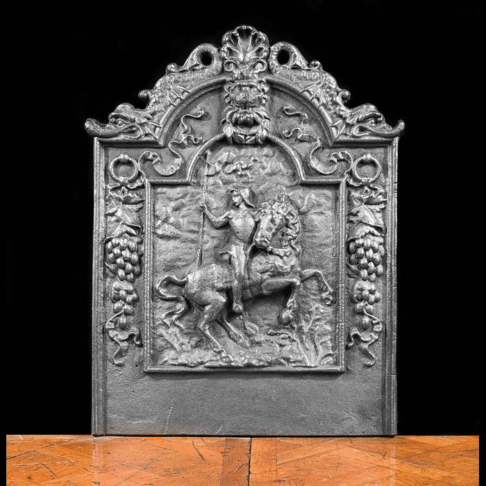 An antique French cast iron fireback.