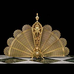 13957: A beautiful and unusually large Rococo gilt brass peacock firescreen topped by a large swagged urn finial and with a delicately pierced sectioned fan. The central stand is finely decorated with a moun