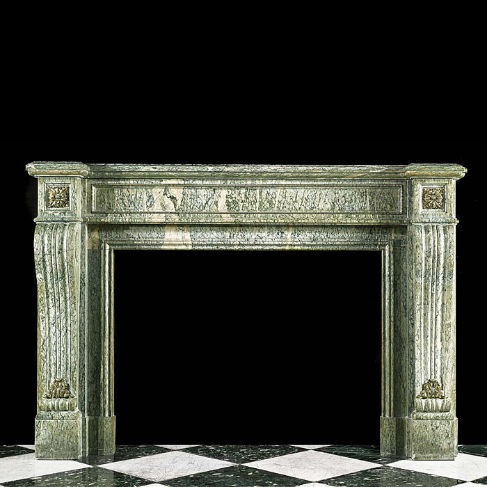 A Louis XVI Antique fireplace surround in green campan marble