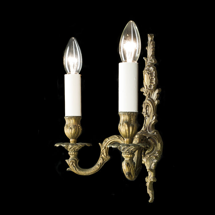 A pair of French brass 20th century wall lights