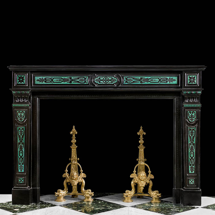 13977: A very rare, fine and striking French Regency exquisitely etched Belgian Black marble chimneypiece decorated with inlaid jewel like terrazzo malachite in the Renaissance manner and with elaborately en
