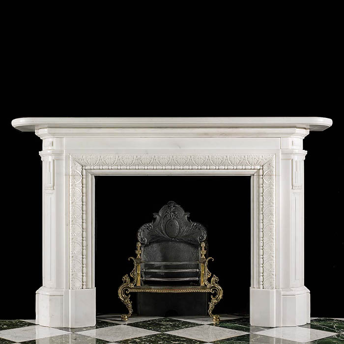 13979: A substantial Regency style white Statuary Marble Chimneypiece. The low, plain frieze and simple panelled end blocks are supported by round cornered, panelled and stop fluted jambs. The fireplace open