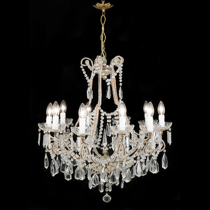A cut glass and brass 20th century ten branch chandelier